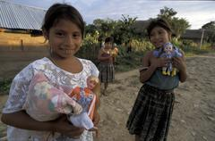 Guatemala girls with dolls for christmas village Stock Photos