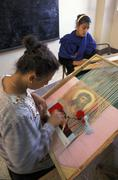 Egypt girls making tapestries catholic social Stock Photos