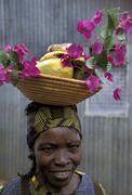 kenya woman female of kibera slum nairobi flower - stock photo