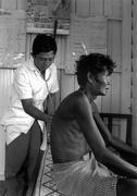Health clinics medic examining man male with tb Stock Photos