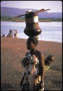 color woman female carrying dishes metangula - stock photo