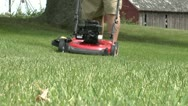 Stock Video Footage of Lawnmowing 90 Degree Pass Low Angle