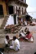 India street barbers at work near the bathing Stock Photos