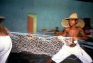 Child kid labor boy performing fisherman dance Stock Photos