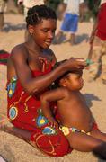 Stock Photo of mozambique mother child kid metangula beach less