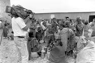 Stock Photo of media us film team making movie during famine at