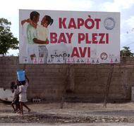 Haiti use condom sign in port au prince photo Stock Photos