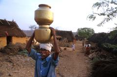 Stock Photo of india water man male carrying from well village
