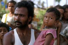 india disasters survivors of cyclone orissa baby - stock photo