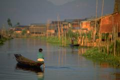 Boy rows floating village inle lake paddle row Stock Photos