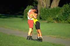 Love couple sport share hug embrace grass golden Stock Photos