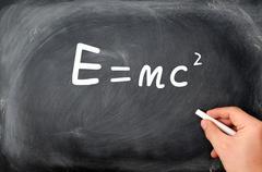 relativity formula written on a  blackboard background - stock photo