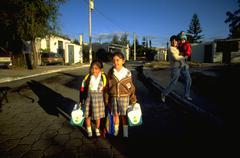 School children kids girls guatemala city pose Stock Photos