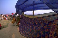 Saris fastened poles wind kumbhmela festival Stock Photos