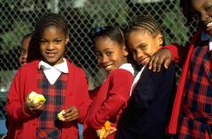 girl school children kids girls embracing apple - stock photo