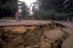 Man male nature measuring crack earthquake san Stock Photos