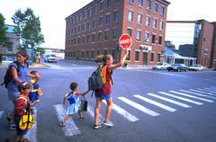 school children kids crossing guard quebec city - stock photo