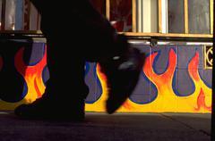 Art fire pair feet walking past painted flames Stock Photos