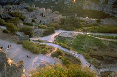 view stone fortress classical buildings hikers - stock photo