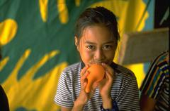 Stock Photo of girl native playfull for camera island baloon