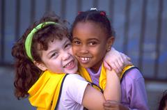 Love girl school children kids multi ethnic hug Stock Photos