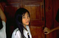 girl child kid school student looks look pretty - stock photo