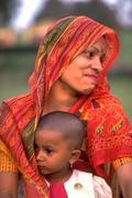 Woman female child kid mother ganhdis tomb boy Stock Photos