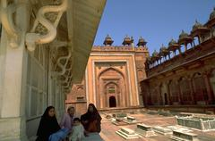 Family sits grounds fatehpur sikri devout men Stock Photos