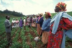 Kenya agronomist addressing women females group Stock Photos