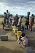 south sudan line waiting for water at well new - stock photo