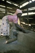 kenya woman female of meru starting kitchen fire - stock photo