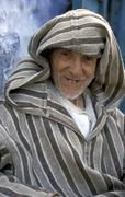 Morocco old man male of chaouen jellaba hood Stock Photos