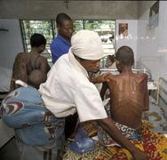 benin relative treating woman female with aids - stock photo