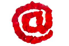 E-mail symbol  made from red petals rose on white Stock Photos