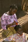Mozambique woman female grooming girl hair comb Stock Photos