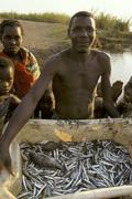 Mozambique fisherman with catch metangula lake Stock Photos