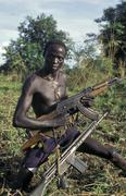 sudan soldier chukudum war ak-47 christian ak - stock photo
