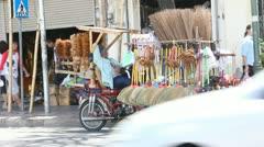 Man selling brooms sleeping Thailand Stock Footage