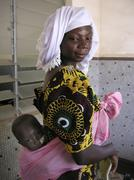 burkina faso mother and babies at nutrition - stock photo