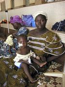 burkina faso mother and baby at nutrition center - stock photo