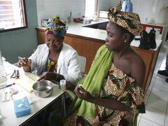 Gambia taking blood for hiv test at wec clinic Stock Photos