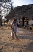 India sarojamma sweeping in front of her house Stock Photos