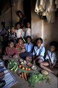 India children kids with healthy vegetables and Stock Photos