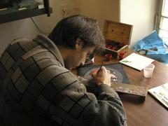 russia art student painting miniature box at the - stock photo