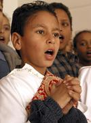 Egypt boy singing in coptic choir el-karma king Stock Photos