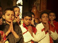egypt orphan boys praying fransiscan fathers el - stock photo