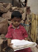 Honduras boy doing his schoolwork at home latin Stock Photos