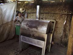 honduras woman female roasting coffee beans on - stock photo