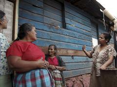 honduras neighbors visiting in slum of latin - stock photo