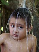 honduras boy taking bath agua caliente near - stock photo